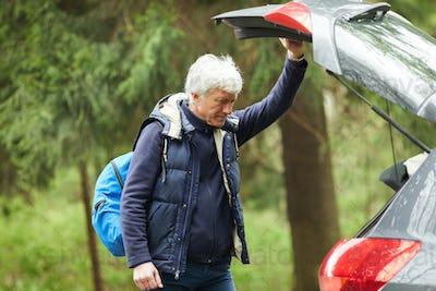 Active Senior Man by Car