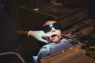 Small boy got dental treatment by dentist