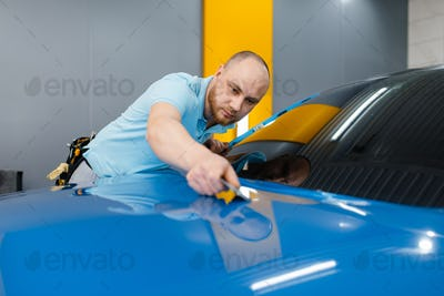 Car wrapper with squeegee installs protective film