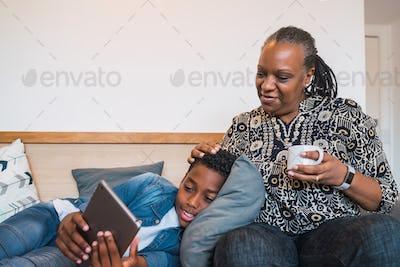Grandmother and grandchild using digital tablet.