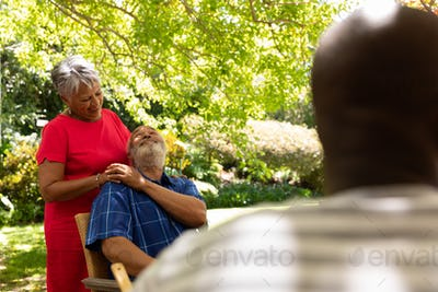 Senior couple embracing each other in the garden