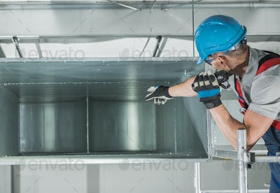 HVAC Technician Performing Scheduled Air Heating and Cooling System Checkup.