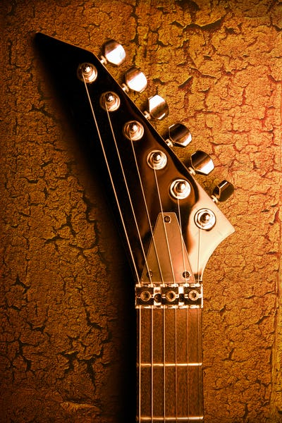top of guitar over grunge background