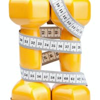 two dumbbells and measuring tape isolated