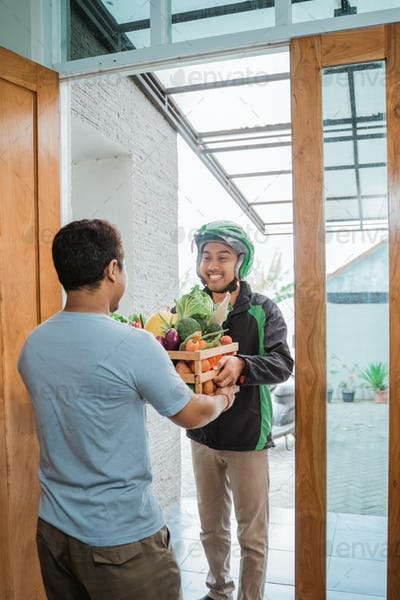 male courier delivering grocery to customer