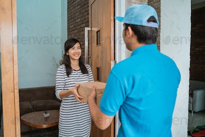 box being delivered to asian woman at home