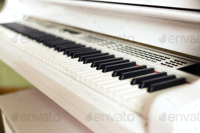 background of electronic grand piano keyboard, close up