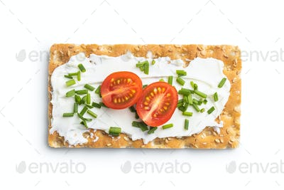Crispbread with creamy cheese, chive and cherry tomatoes