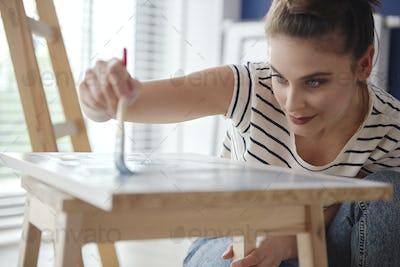 Close up of woman making DIY renovation