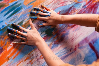 Hands of artist with paint