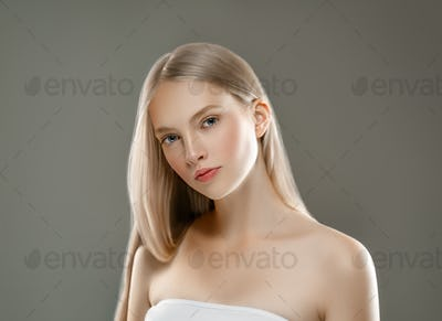 Beautiful Woman Face Portrait Beauty Skin Care Concept with long blonde hair  over gray background