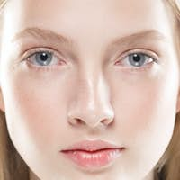 Close up face woman with beauty skin and beautful blond hair isolated on white