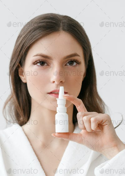 Throat pain spray woman with sick breath. Studio shot.