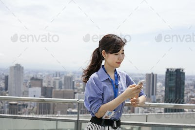 A working woman on a balcony.