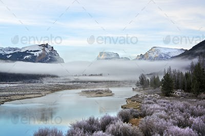 View of Squaretop Mountain, and the Wind River, at dawn, with low hanging mist over the valley.