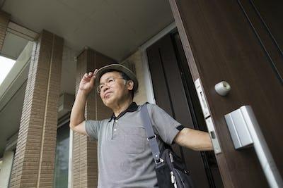 A man standing at his front door.