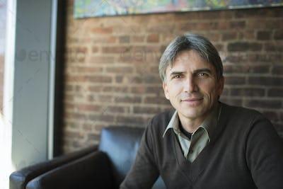 A man sitting in a coffee shop.
