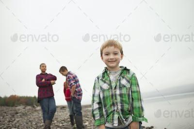 A day out at Ashokan lake. Three teenagers and a young boy on shore.
