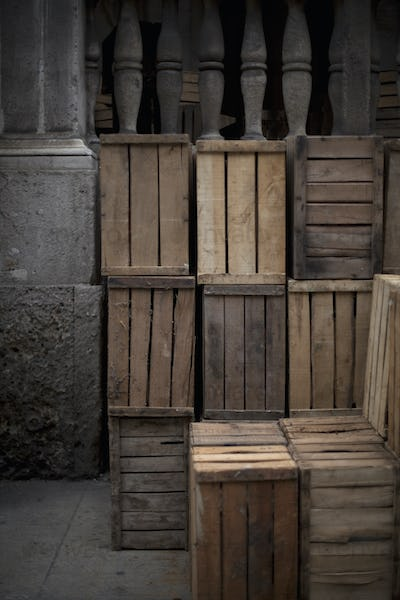 A stack of wooden crates, in the corner of a room.