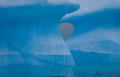 Icebergs with eroding and changing form drifting on the water, Antarctica