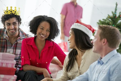 Christmas, woman wearing a red and white Father Christmas hat,