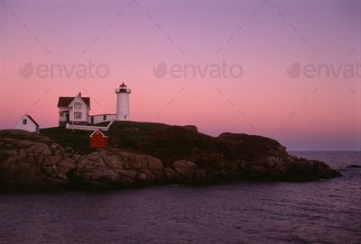 Cape Neddick and the Nubble Lighthouse, on a headland on the Maine coastline at sunset.
