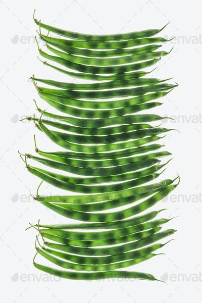 Organic green string beans on white background