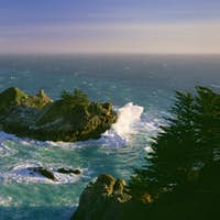 The coastline and a horseshoe bay with waves crashing against the rocks