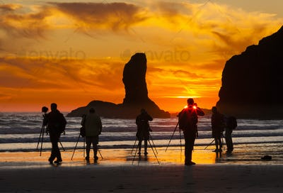 Photographers at sunset at Second Beach, Olympic National Park, Washington, USA