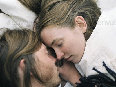 Close up of young couple sleeping.