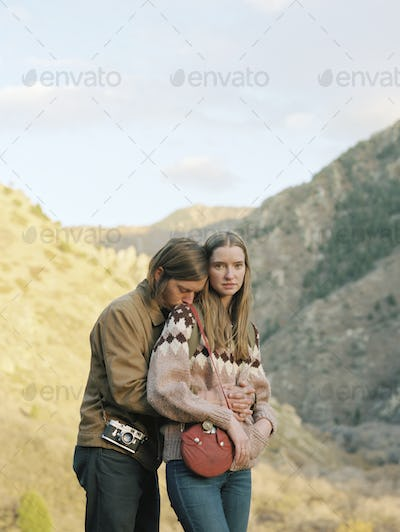 Young couple standing in a canyon.