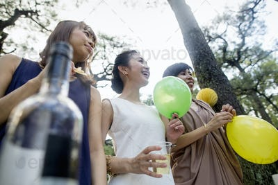 Group of friends at an outdoor party in a forest.