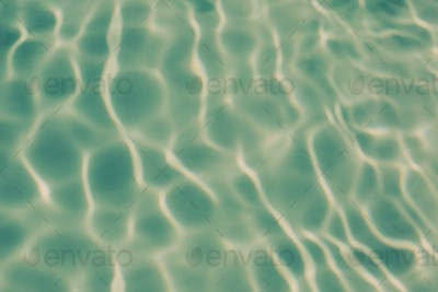 Ripple patterns on the water in a pool.