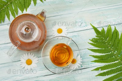 Herbal tea in teapot and cup