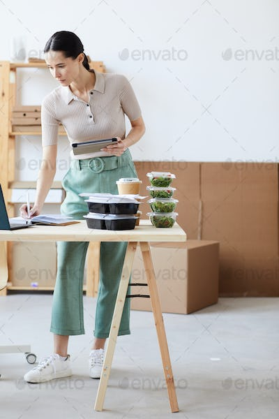 Woman working in delivery service