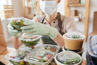 Woman packing fresh vegetables
