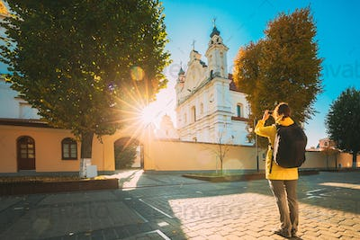 Pinsk, Brest Region, Belarus. Young Woman Tourist Lady Photograph Taking Pictures Near Cathedral Of