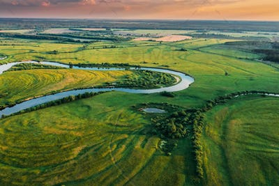 Belarus. Aerial View Of Green Forest, Meadow And River Landscape In Sunny Evening. Top View Of