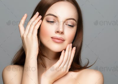 Woman beauty clean healthy skin manicure nails hands touching face cosmetic spa