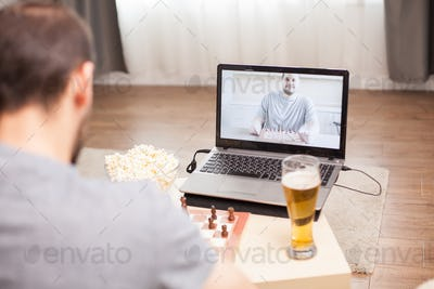 Intelligence friends playing chess on video call