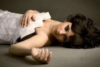 Cute young caucasian sad girl in origami