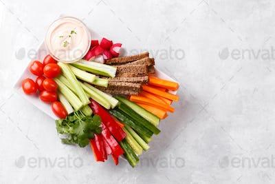 Healthy vegetables snack with yogurt