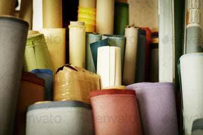 Rolls of materials, fabric and leather used in book binding.