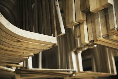 Close up of wooden furniture pieces in a carpentry workshop.