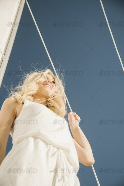 Blond teenage girl on a sail boat.