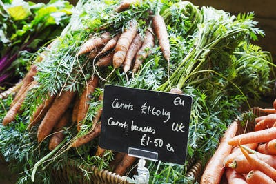Organic carrots being sold in a farm shop.