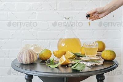 A jug of orange juice and fresh fruit.
