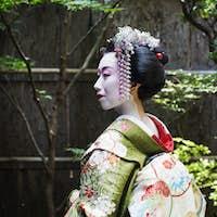 Geisha in costume outdoors