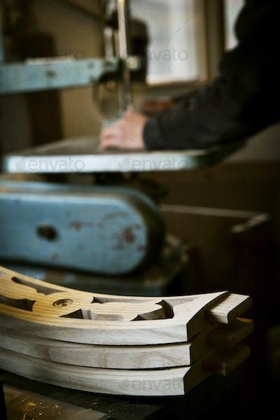 Carpenter making a chair