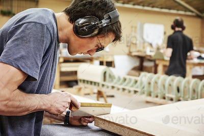 Man making wood furniture